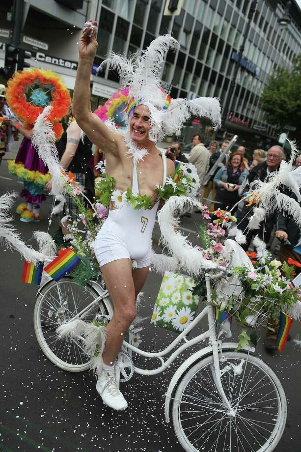 Berlin, GermanyA man on a bicycle participates in the annual Christopher Street Day parade on Kurfuerstendamm avenue on Saturday, June 21, 2014 in Berlin, Germany. This year the annual gay and lesbian pride fest was divided into three different parades due to quarrels over the political aims of the event. Berlin, known as a tolerant and open city, has a very active gay community. Photo: Sean Gallup, Getty Images / 2014 Getty Images