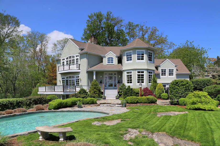 The Nantucket-style Colonial at 142 Five Mile River Road in Darien has panoramic views of Long Island Sound. It is on the market for $4,395,000. Photo: Contributed Photo, Contributed / Darien News