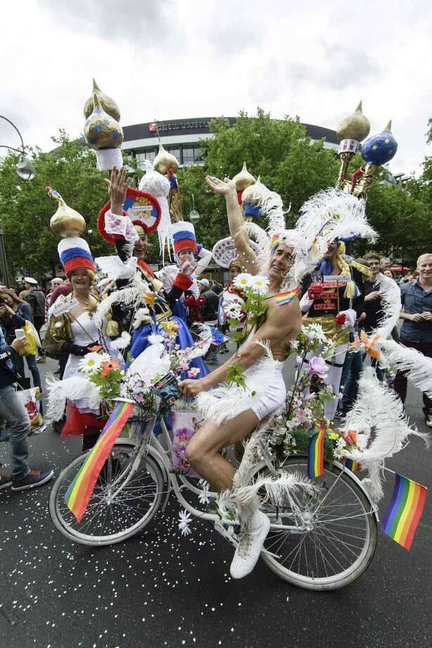Berlin, GermanyParticipants wear hats featuring Russian church domes and throw confettis during the Christopher Street Day (CSD) gay pride parade in front of Berlin's Memorial Church (Gedaechtniskirche) in Berlin, Germany on Saturday, June 21, 2014.   Photo: CLEMENS BILAN, AFP/Getty Images / AFP ImageForum