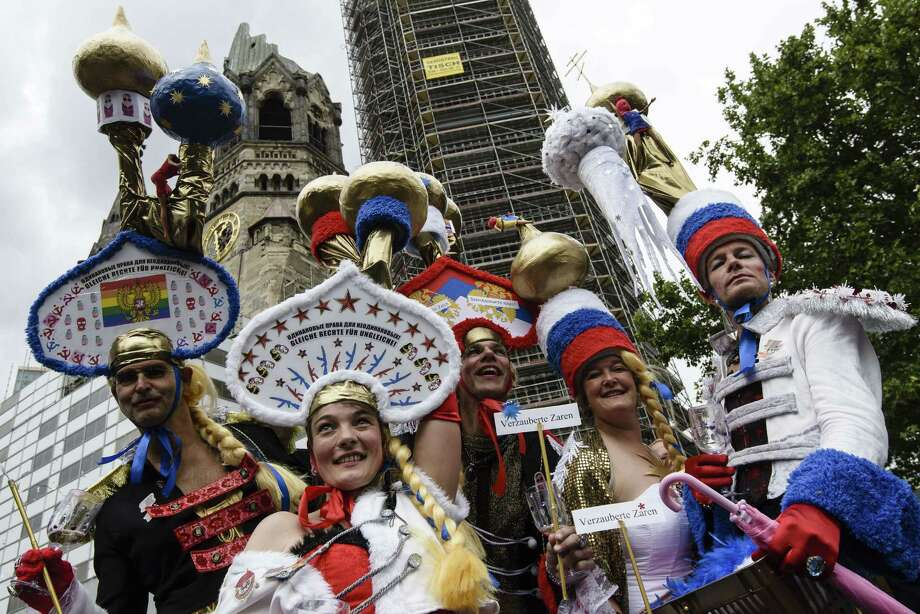 Berlin, GermanyParticipants wear hats featuring Russian church domes during the Christopher Street Day (CSD) gay pride parade in front of Berlin's Memorial Church (Gedaechtniskirche) in Berlin, Germany on Saturday, June 21, 2014.   Photo: CLEMENS BILAN, AFP/Getty Images / AFP ImageForum