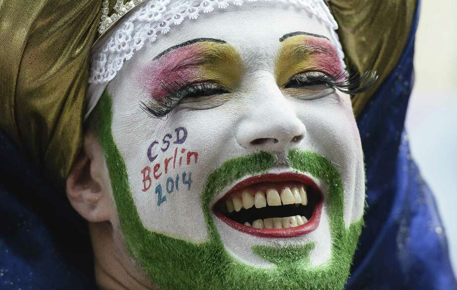 Berlin, GermanyA man has his beard painted in green as he attends the Christopher Street Day (CSD) gay pride parade in front of Berlin's Memorial Church (Gedaechtniskirche) in Berlin, Germany on Saturday, June 21, 2014.  Photo: CLEMENS BILAN, AFP/Getty Images / AFP ImageForum
