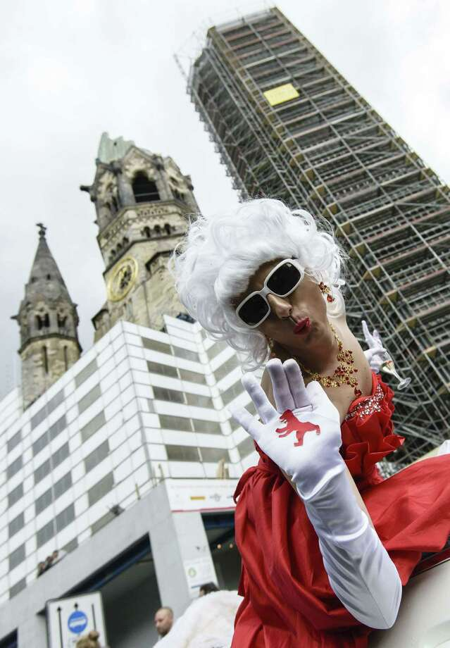 Berlin, GermanyA participant of the Christopher Street Day (CSD) gay pride parade waves in front of the Memorial Church (Gedaechtniskirche) in Berlin, Germany on Saturday, June 21, 2014.   Photo: CLEMENS BILAN, AFP/Getty Images / AFP ImageForum