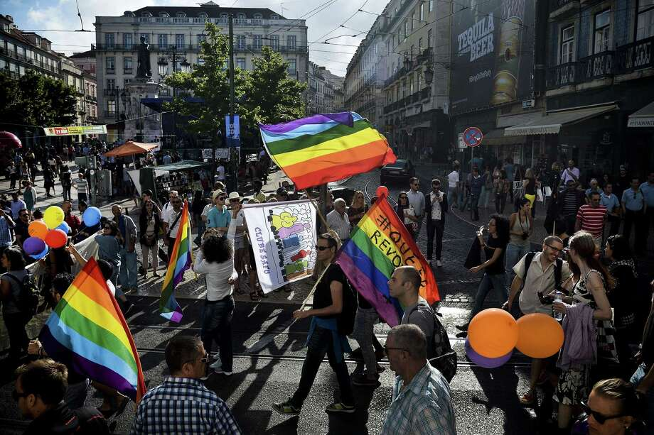 Lisbon, PortugalPeople take part in the Gay Pride Parade in Lisbon, Portugal on Saturday, June 21, 2014.   Photo: PATRICIA DE MELO MOREIRA, AFP/Getty Images / AFP ImageForum