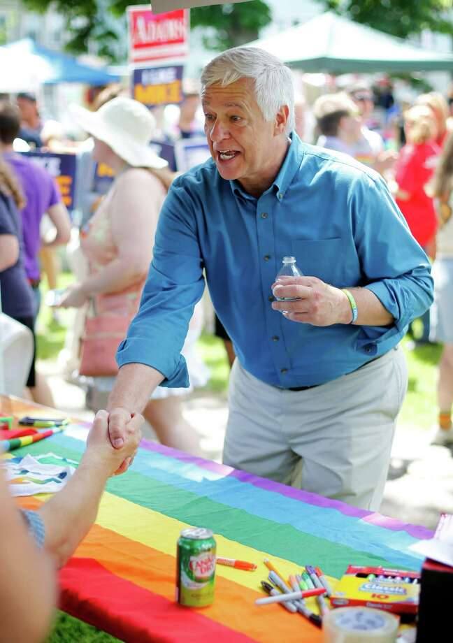 Portland, MaineU.S. Rep. Mike Michaud, a Democratic candidate for governor, shakes hands after the Portland Pride Parade, Saturday, June 21, 2014, in Portland, Maine. Gay rights activists around the country are eyeing the Maine's governor's race as a chance to make history. Michaud would become the first openly gay candidate to become governor if he unseats vulnerable Republican Gov. Paul LePage in November.  Photo: Robert F. Bukaty, Associated Press / AP