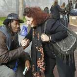 Angela Alioto (right) stops to say hello to an old friend, Skinny Charles Thomas Moore in the United Nations plaza. Ten years after the Care Not Cash program in San Francisco, Calif. went into effect, Angela Alioto reflects on the progress to end homelessness.