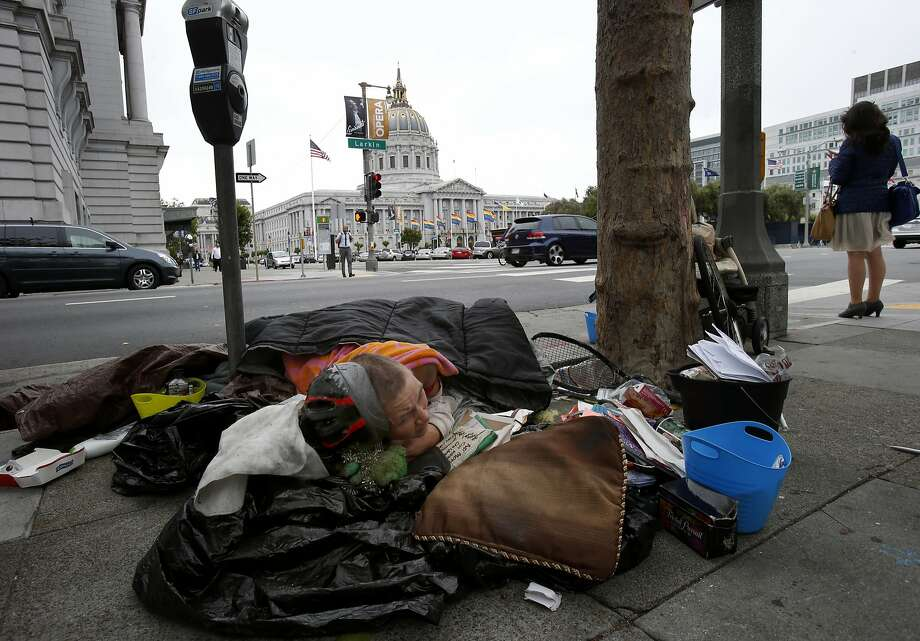 "Surviving the streets: A homeless woman who calls herself ""U"" camps within sight of San Francisco City Hall. Photo: Brant Ward, The Chronicle"