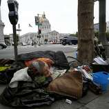 "Surviving the streets: A homeless woman who calls herself ""U"" camps within sight of San Francisco City Hall."