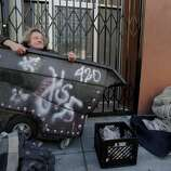 Harold (left), a longtime homeless man, wakes in the morning with other homeless outside a motel on Mission Street. In San Francisco, Calif. it has been ten years since the Care Not Cash program was initiated and to end chronic homelessness but the results have not been as hoped.