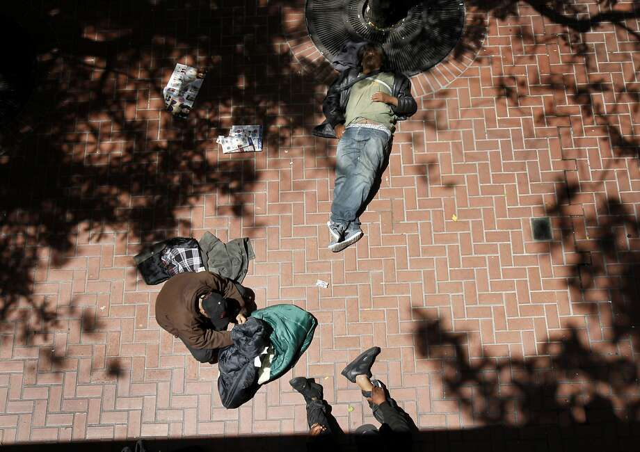 Near the Powell Street BART station, a group of homeless men find some shade in San Francisco, Calif. Photo: Brant Ward, The Chronicle