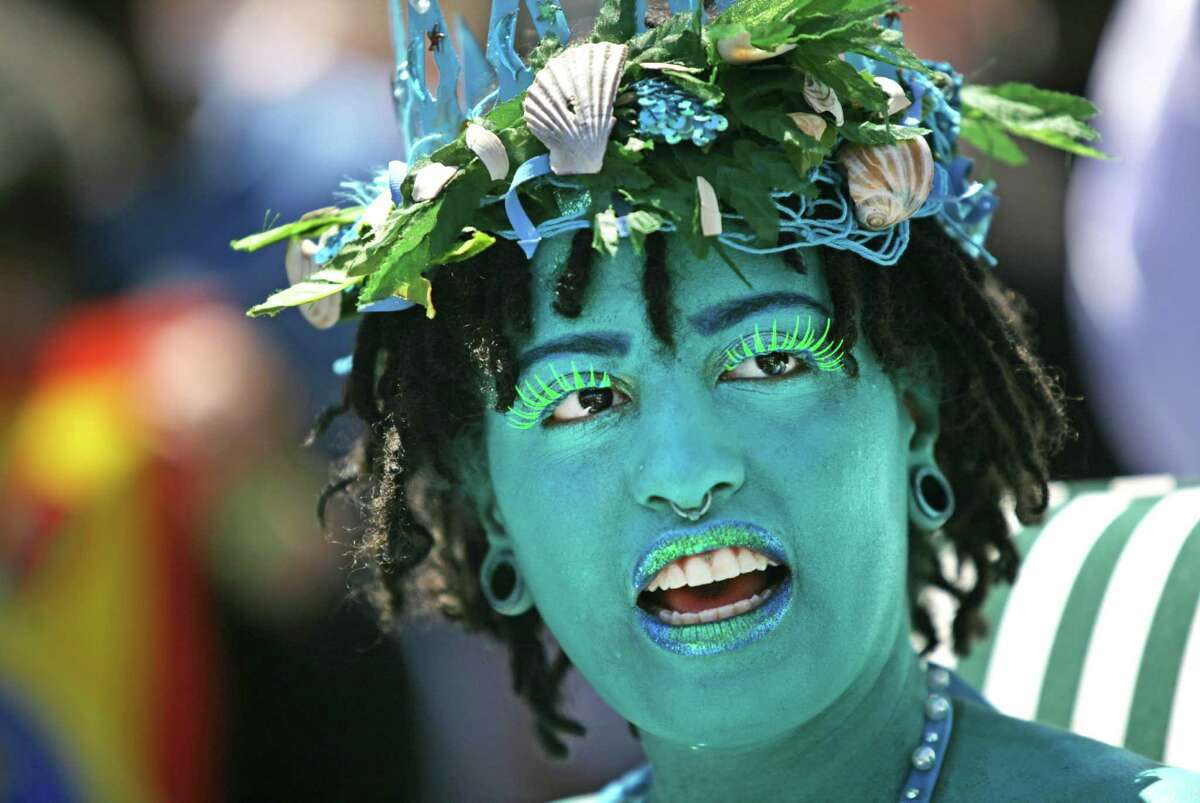 NEW YORK, NY - JUNE 21: Chiara de Blasio, daughter of New York City Mayor Bill de Blasio, attends the 2014 Mermaid Parade at Coney Island on June 21, 2014 in the Brooklyn borough of New York City. The Mermaid Parade began in 1983 and features participants dressed as mermaids and other sea creatures while paying homage to the former tradition of the Coney Island Mardi Gras which ran annually in the early fall from 1903-1954. This year New York City Mayor Bill de Blasio and his wife Chirlane McCray attended in costume along with their two children Dante and Chiara de Blasio who were chosen as King Neptune and Queen Mermaid, the highest held positions of the parade. (Photo by Yana Paskova/Getty Images) ORG XMIT: 494993547