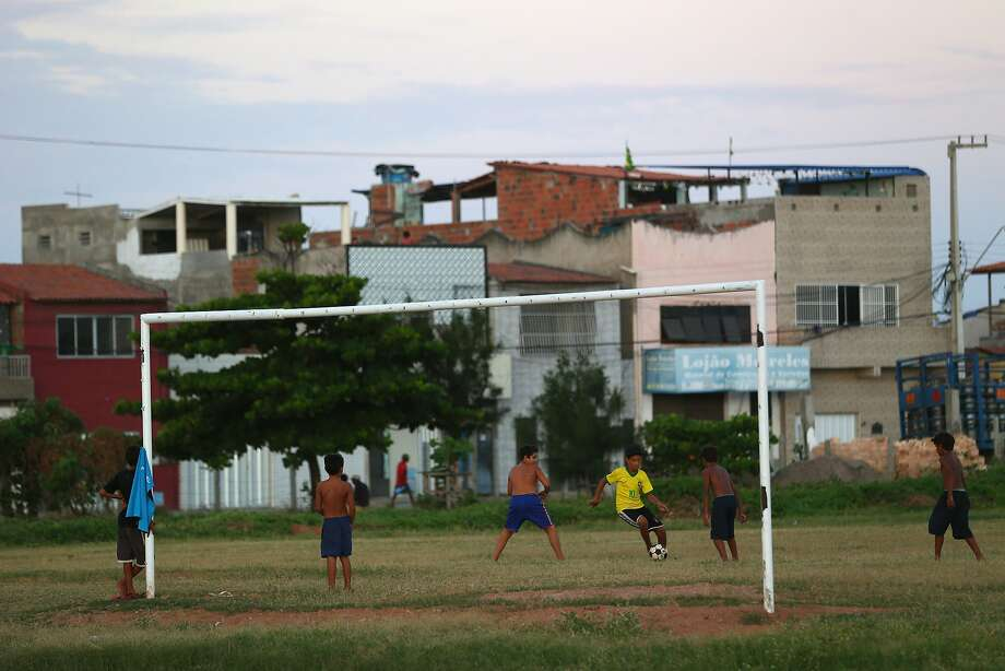 Local kids play soccer at the Serviluz favela in Fortaleza. Photo: Michael Steele, Getty Images