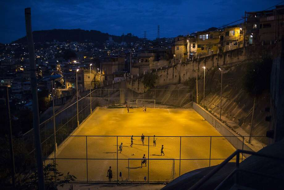 "While tourists enjoy the World Cup in brand-new venues and hotels all over Brazil, the nation's poorest residents are struggling — sometimes violently — to survive in enormous shantytowns known as ""favelas."" A total of 1.7 million Brazilians live in Rio de Janeiro's favelas, many of 