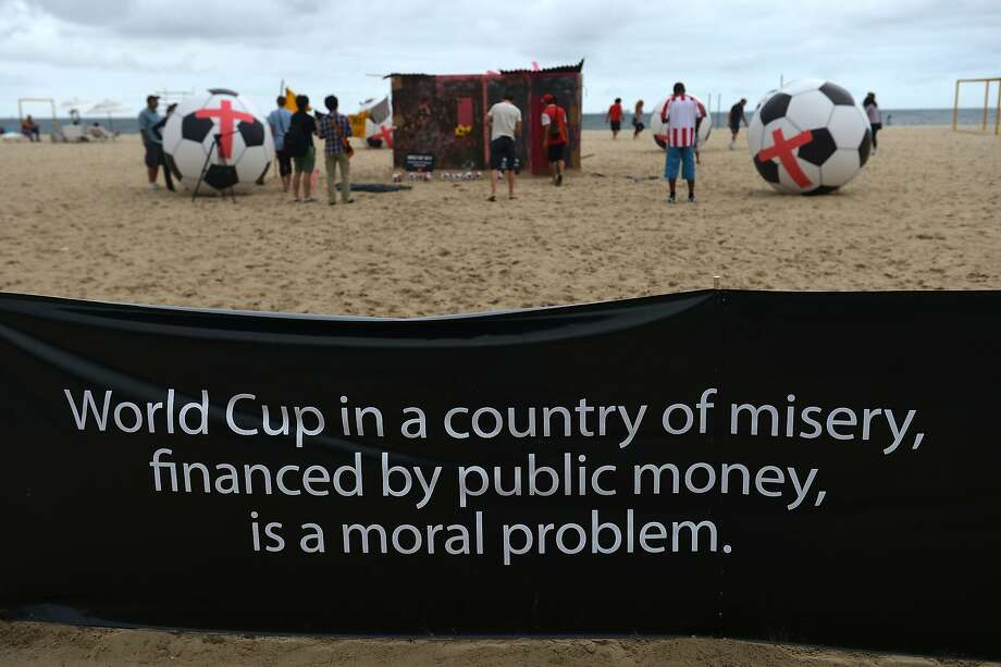 Brazilians install art pieces on Copacabana Beach in Rio de Janeiro for an anti-World Cup protest two days before the opening game.  Photo: Gabriel Bouys, AFP/Getty Images