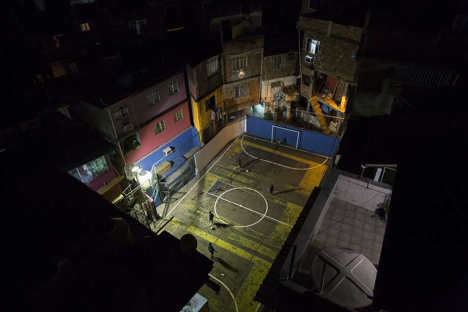Soccer is ubiquitous in the favelas, and kids grow up playing a colorful and energetic brand of street soccer. Here, people play in the Tavares Bastos favela in Rio de Janeiro.  Photo: Felipe Dana, Associated Press