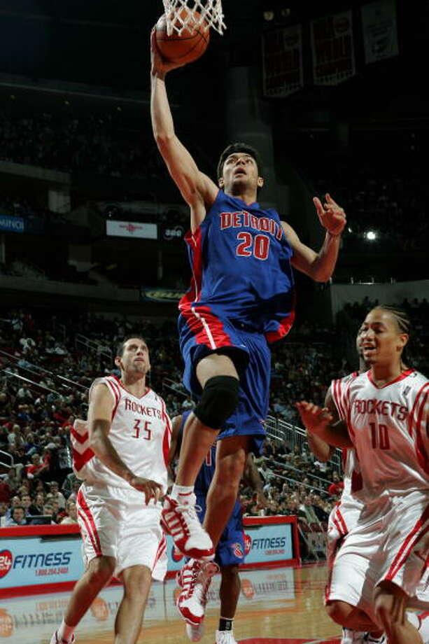 2003 – Detroit– Carlos Delfino (Argentina)The shooting guard had stints in Detroit and Toronto before heading to Milwaukee in 2009, where he would average 11.5 points per game the next two seasons. He spent 2012-13 with the Rockets before signing with Milwaukee last summer. He didn't play because of a foot injury and is expected to return next season. Photo: Bill Baptist, NBAE/Getty Images / 2004 NBAE