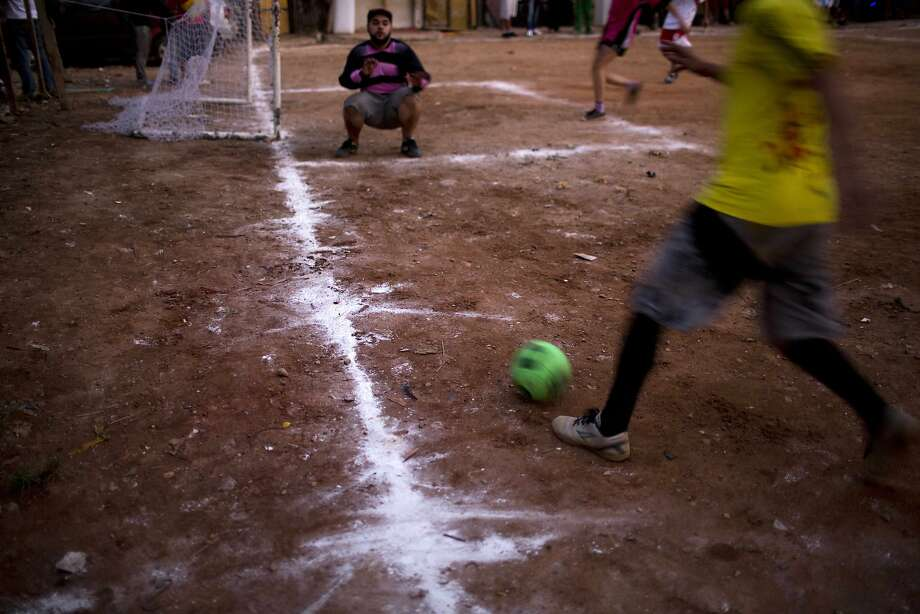 Residents play soccer in Favela Moinho in Sao Paulo. Photo: Rodrigo Abd, Associated Press