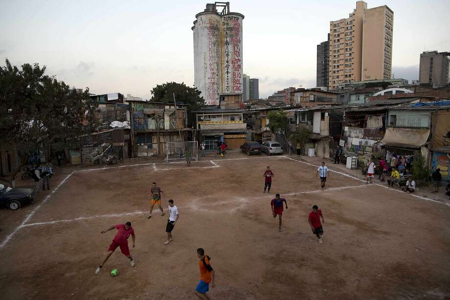 Residents play soccer in Favela Moinho in Sao Paulo, Brazil. Photo: Rodrigo Abd, Associated Press