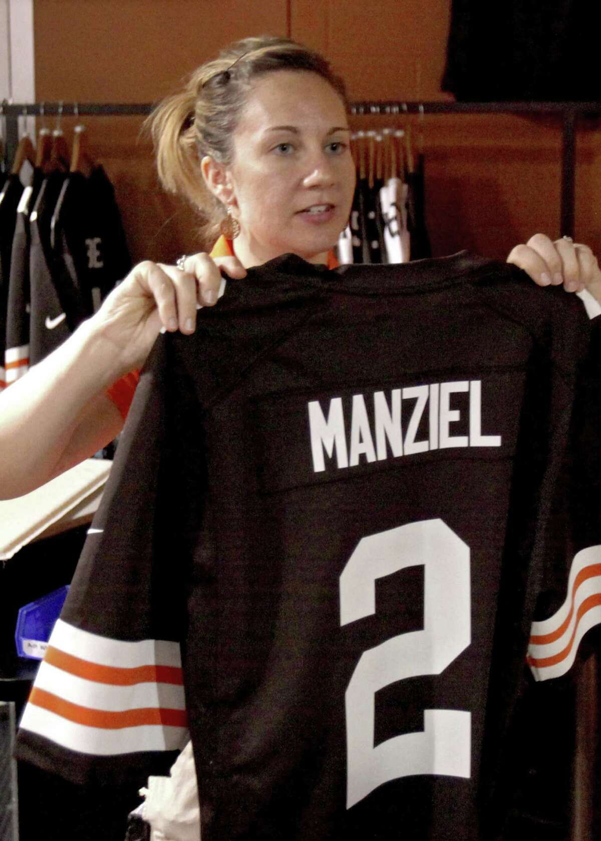 Bethany Davis holds up a Browns' Johnny Manziel jersey for a customer in Cleveland.