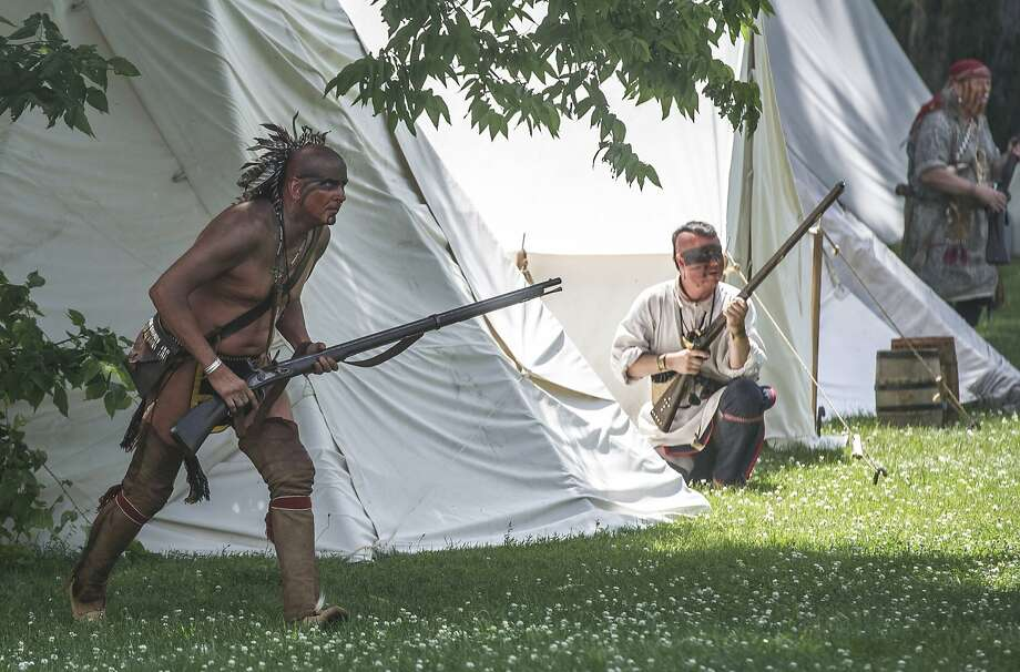 Raiding party:History buffs dressed as Native American tribesmen re-enact the raid of the Fort Harrod Settlement in 