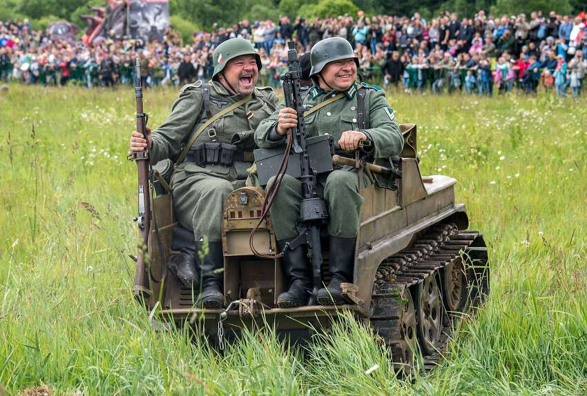 Jolly Jerries: Military history enthusiasts dressed as German troops stage a re-enactment of the 1941 battle near the village of Ivanovskoye, about 20 miles from Moscow, during the Nazi invasion of the Soviet Union. They are in particularly good humor considering the Wehrmacht advance will never capture the Russian capital.