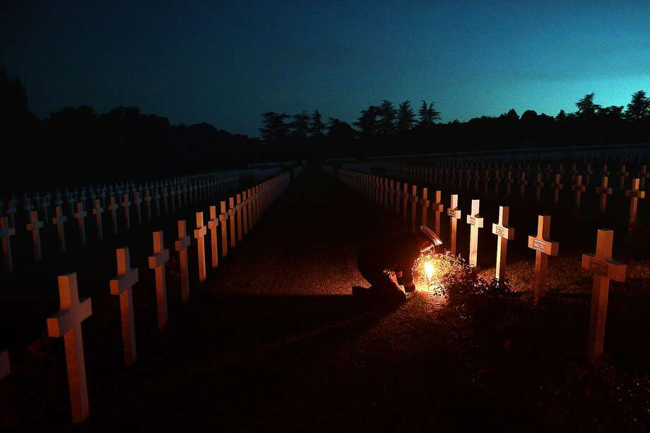 Verdun nears century mark: A torchlight is placed next to a soldier's gravesite at Douaumont's Boneyard 