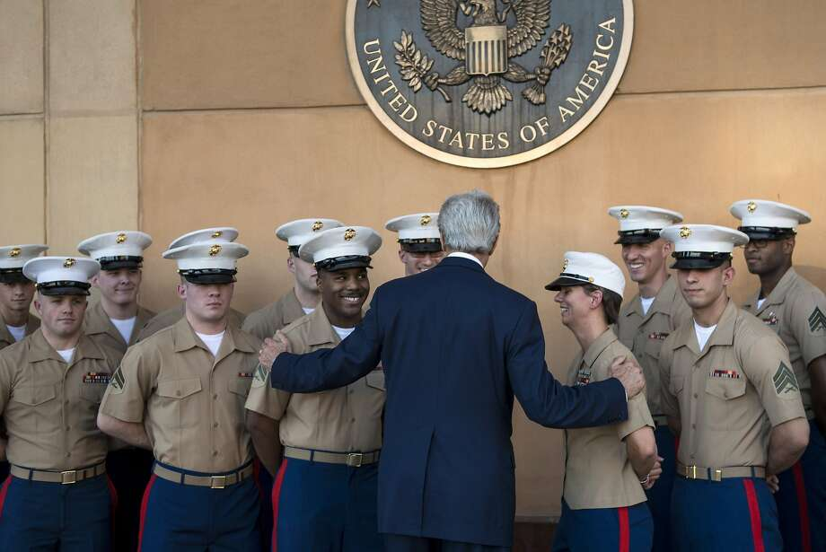 "TOPSHOTS US Secretary of State John Kerry greets US marines as he arrives at the US embassy in the International Zone June 23, 2014 in the Iraqi capital Baghdad. Kerry pledged ""intense"" support for Iraq against the ""existential threat"" of a major militant offensive pushing toward Baghdad from the north and west.     AFP PHOTO / POOL / BRENDAN SMIALOWSKIBRENDAN SMIALOWSKI/AFP/Getty Images Photo: Brendan Smialowski, AFP/Getty Images"