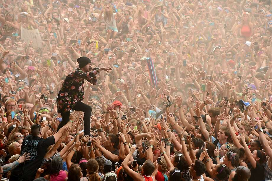 Pilot soloing:Tyler Joseph of Twenty One Pilots crowd-surfs standing up as he sings during the Firefly Music Festival in Dover, Del. Photo: Theo Wargo, Getty Images