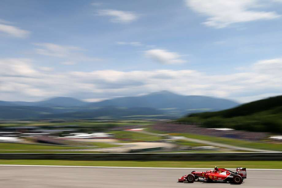 Zoom photography:Ferrari driver Kimi Raikkonen of Finland speeds down a straightaway during a qualifying session of the Austrian Formula One Grand Prix in Spielberg. Photo: Dom Romney, Getty Images