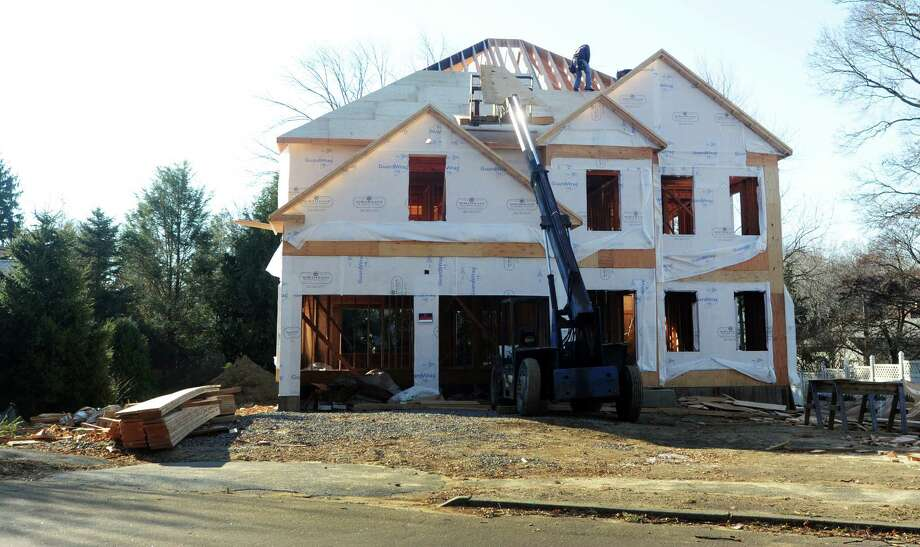 A large house is being built to replace the smaller home that one stood at 567 Judd St. in Fairfield, Conn. on Friday, Nov. 29, 2013. Photo: Cathy Zuraw / Connecticut Post