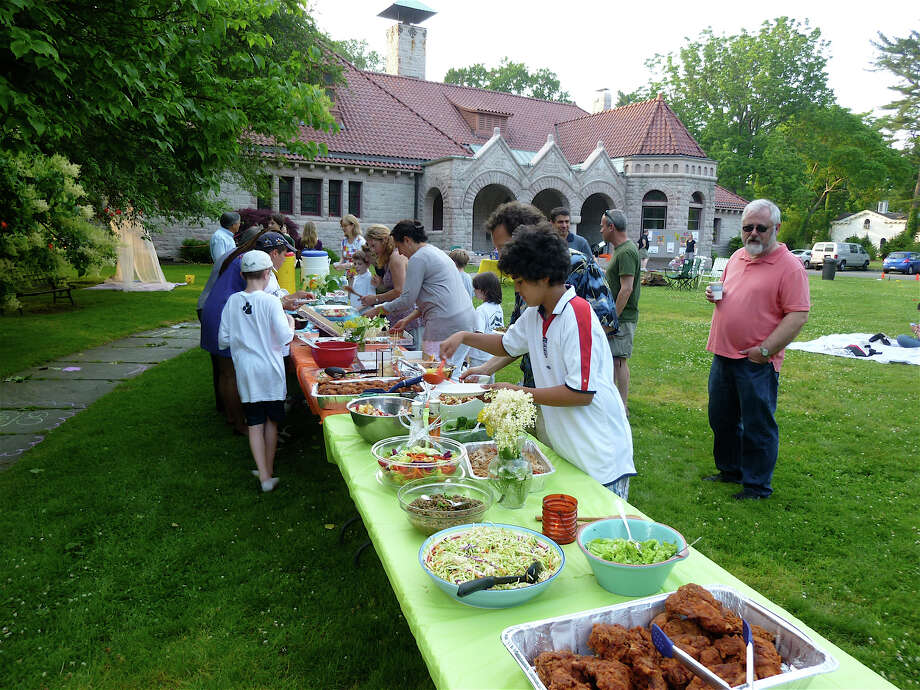 Food galore was featured at last year's potluck supper and camp out at the Pequot Library. This year's version of the annual event in set Friday, June 27, and will include children's games, live music, marshmallow toasting, a pillow fight and --- for the adventuresome -- -overnight camping. Photo: Contributed Photo/Mike Lauterbor, ST / Fairfield Citizen contributed