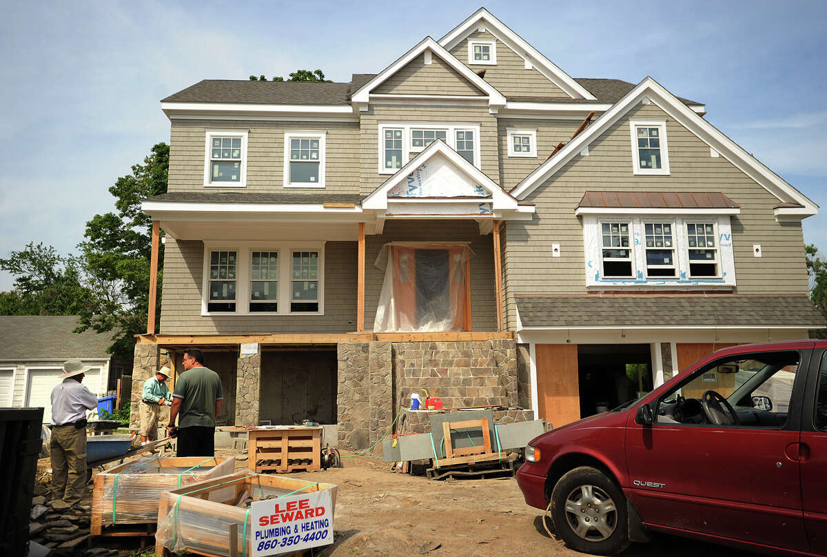 In the wake of Superstorm Sandy, a large new home being constructed on Rowland Road in Fairfield, Conn. on Monday, June 23, 2014.