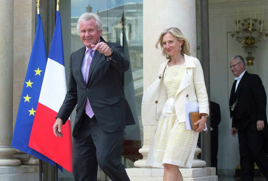 General Electric Co. CEO Jeffrey R. Immelt and GE France chairwoman Clara Gaymard leave the Elysee Palace after a meeting with French President Francois Hollande at the Elysee Palace, Friday, June 20, 2014. GE looks set to complete its acquisition of French industrial giant Alstom. (AP Photo/Michel Euler) Photo: Michel Euler, Associated Press / Stamford Advocate Contributed