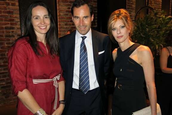 Square CFO Sarah Friar (left) with Elle Publisher Kevin O'Malley and Editor-in-Chief Robbie Myers at Quince Restaurant. June 2014. By Catherine Bigelow.