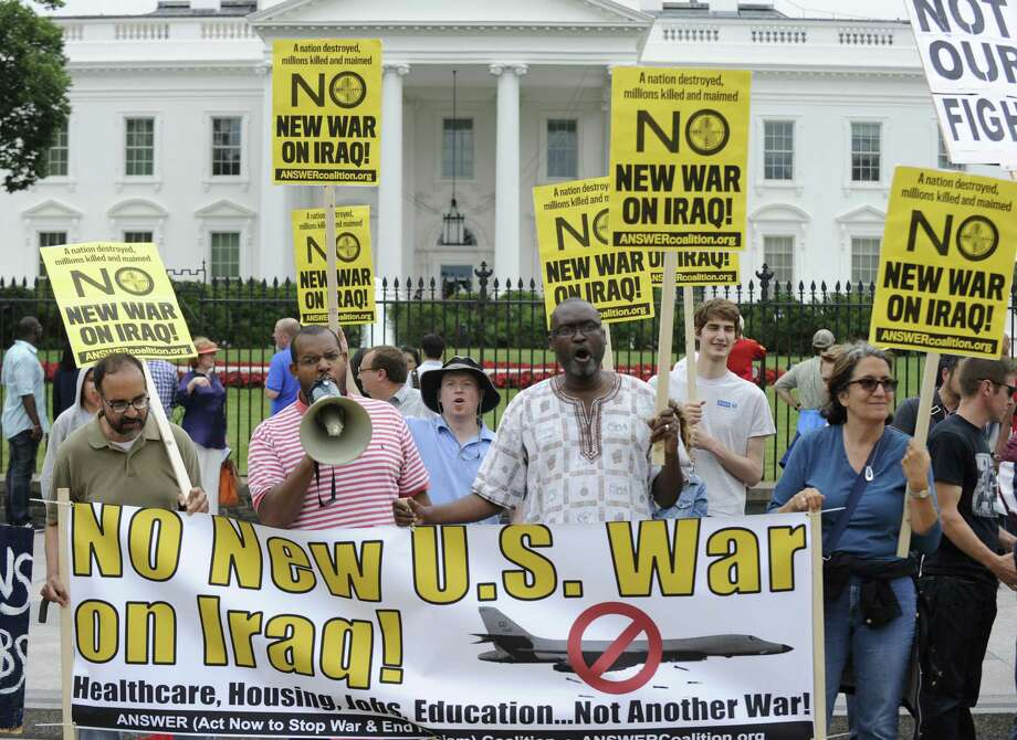 Demonstrators protest against renewed U.S. involvement in Iraq. However, sustained U.S. action is needed to inspire confidence among Iraqis and to stabilize the nation. Photo: Susan Walsh / Associated Press / AP
