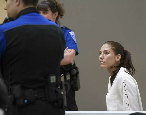 U.S. women's soccer team goalkeeper Hope Solo appears in Kirkland Municipal Court on Monday, June 23, 2014, in connection with her domestic violence arrest at her sister's home in Kirkland, Wash. Photo: Mike Siegel, AP / Pool, The Seattle Times
