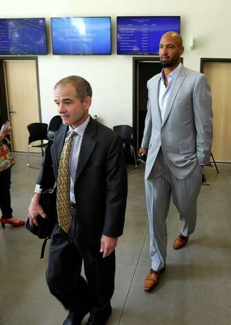 Jerramy Stevens, right, the husband of U.S. women's soccer goalkeeper Hope Solo, walks out of Kirkland Municipal Court Monday, June 23, 2014, in Kirkland, Wash. with Todd Maybrown, Solo's attorney. Solo appeared in court in connection with her arrest for domestic violence Saturday in Kirkland, where she was accused of assaulting her sister and 17-year-old nephew. Photo: Ted S. Warren, AP / AP