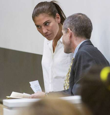 U.S. women's soccer team goalkeeper Hope Solo listens to her attorney Todd Maybrown in Kirkland Municipal Court on Monday, June 23, 2014, in Kirkland, Wash. Solo has entered a not guilty plea following her domestic violence arrest at her sister's home in suburban Seattle. Photo: Mike Siegel, AP / Pool, The Seattle Times