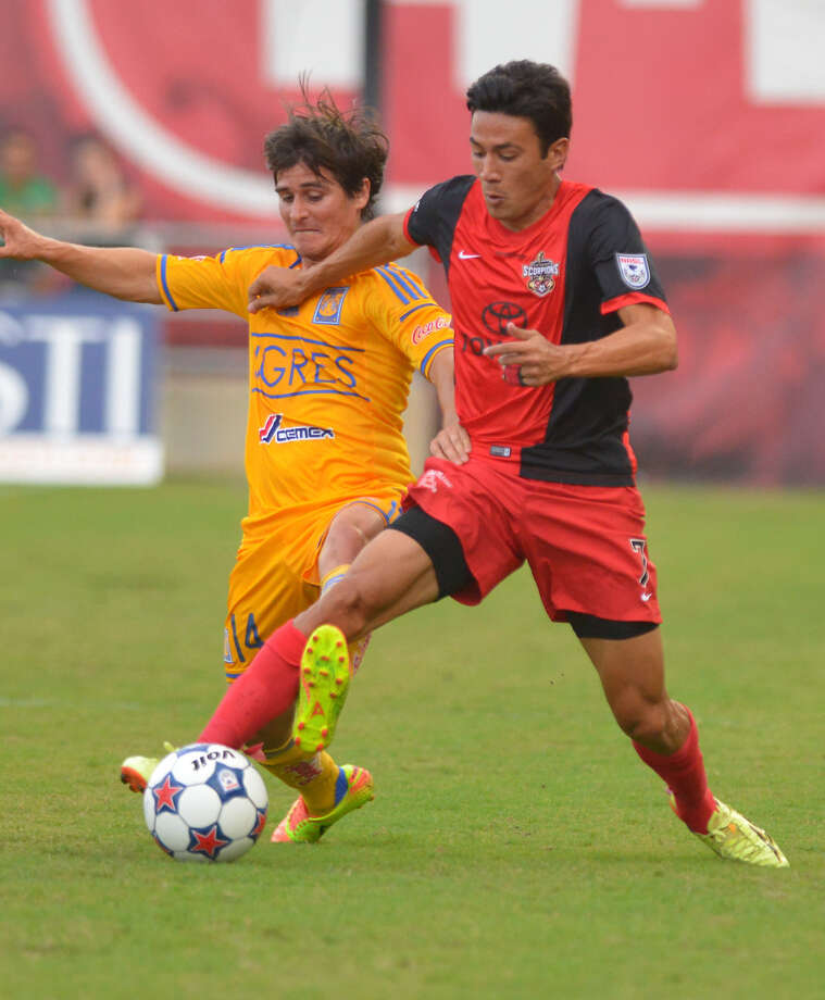Walter Restrepo, right, of the San Antonio Scorpions battles Jorge Estrada of the Tigres during first half action Saturday night at Toyota Field. Photo: Robin Jerstad / For The San Antonio Express-News