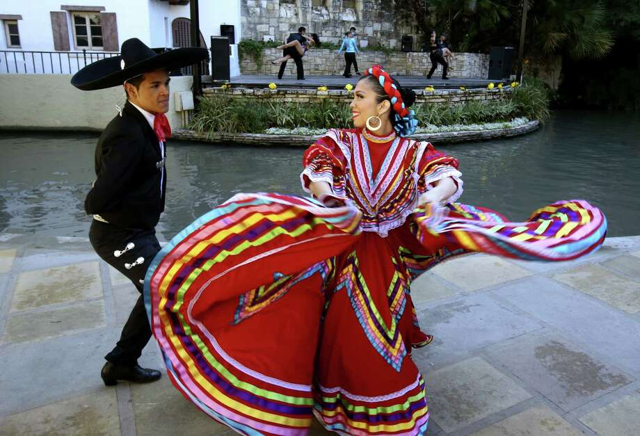 Roger Mendoza and Jennifer Castillo, cast members of Fiesta Noche Del Rio, whirl through a traditional Mexican dance at the popular outdoor stage show, now in its 58th season. Photo: Helen L. Montoya / San Antonio Express-News / ©2014 San Antonio Express-News