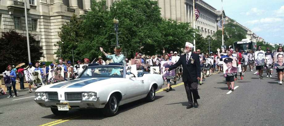 Mary Virginia McCormick Pittman-Waller, a national director and representative of the Navy League of the United States, waves to the crowd at the National Memorial Day Parade in Washington, D.C. Photo: Courtesy / Navy League Austin