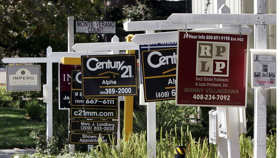 FILE - Signs for several existing homes for sale are seen in San Jose, Calif., in this, Sept. 4, 2007 file photo. The National Association of Realtors reports how many people signed contracts to buy existing homes in April later Thursday May 29, 2014.  (AP Photo/Paul Sakuma, File) Photo: Paul Sakuma, Associated Press