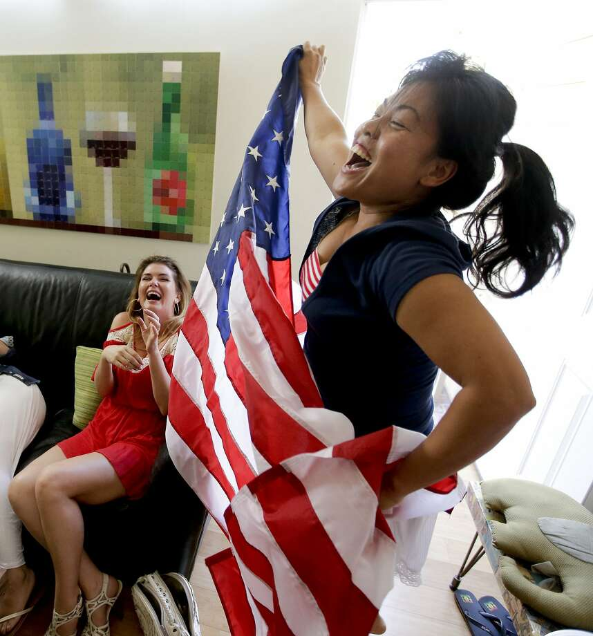 While watching the game in Newport Beach (Orange County), Tina Termsomket celebrates a U.S. goal Sunday. Photo: Chris Carlson, Associated Press