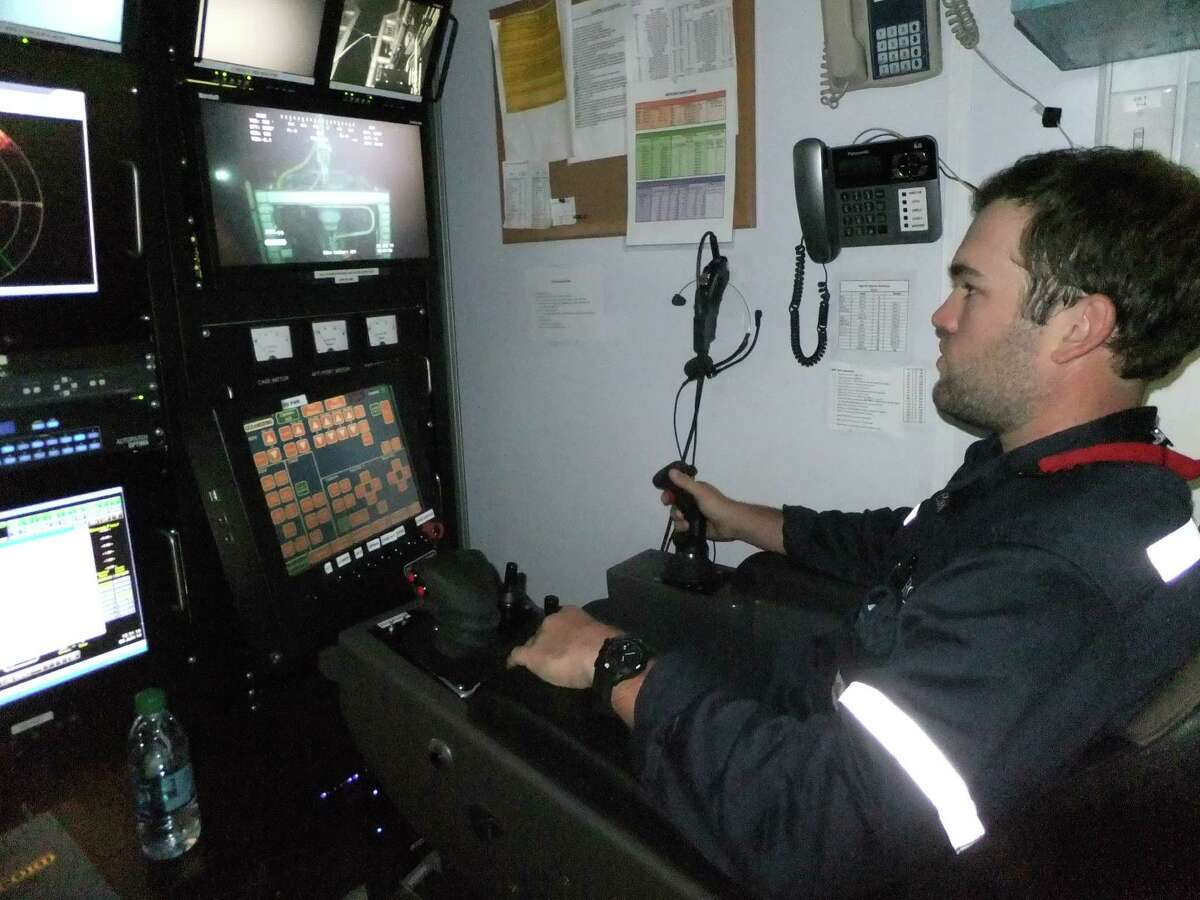 Corey Halsell, a junior remotely operated vehicle technician for Oceaneering, uses an ROV to monitor the blowout preventer on a drillship working for Shell. When ROV s aren t performing such oil field tasks, some companies including Oceaneering use them to search of sea life under a program called Scientific and Environmental ROV Partnership using Existing Industrial Technology -- SERPENT. (Ryan Holeywell/Chronicle)