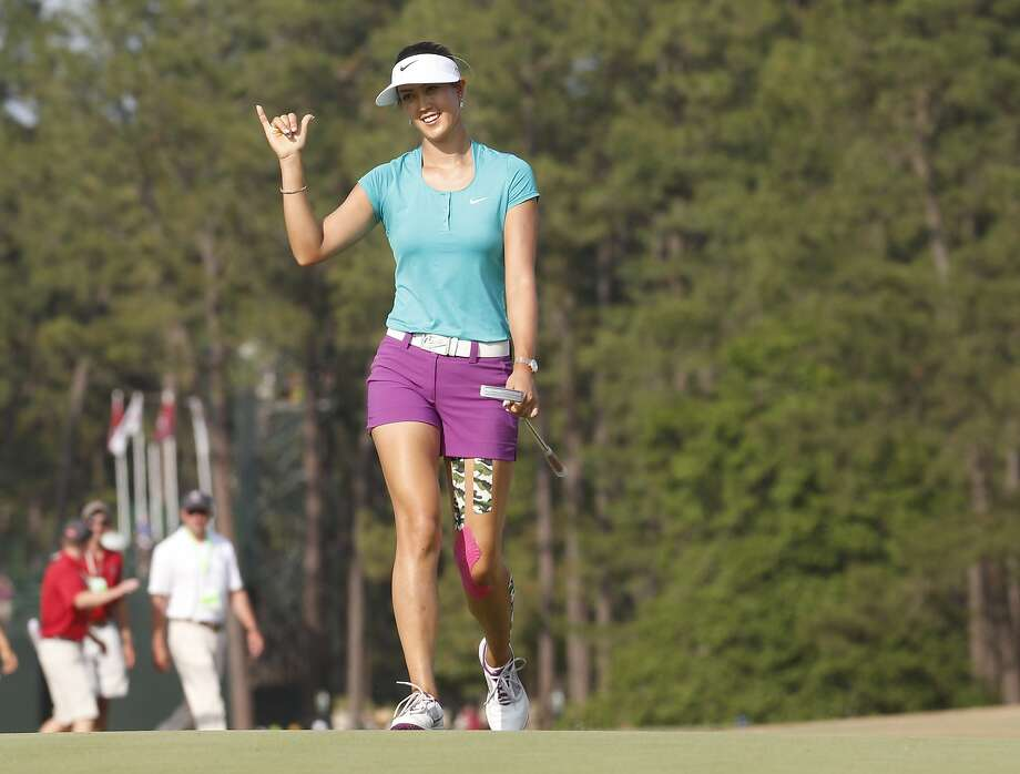 Michelle Wie walks to the 18th green of the U.S. Women's Open on Sunday at Pinehurst. Photo: John Bazemore, Associated Press