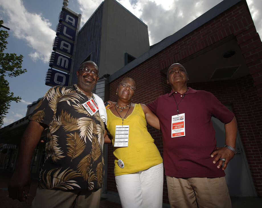 Freedom Riders Hezekiah Watkins, left, and Jesse James Davis, right, pose with Davis' sister Barbara Bowie in 2011 near Jackson, Mississippi's Alamo Theater. They were attending the Freedom Riders' 50th reunion held there. Photo: San Antonio Express-News File Photo / San Antonio Express-News