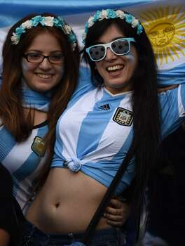 Argentina fans react during the Group F football match between Argentina and Iran at the Mineirao Stadium in Belo Horizonte during the 2014 FIFA World Cup in Brazil on June 21, 2014.  AFP PHOTO / BEHROUZ MEHRI        (Photo credit should read BEHROUZ MEHRI/AFP/Getty Images) Photo: AFP/Getty Images