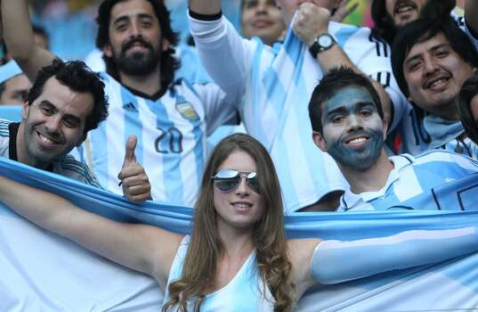 Argentina fans celebrate during the Group F football match between Argentina and Iran at the Mineirao Stadium in Belo Horizonte during the 2014 FIFA World Cup in Brazil on June 21, 2014.  AFP PHOTO / BEHROUZ MEHRI        (Photo credit should read BEHROUZ MEHRI/AFP/Getty Images) Photo: AFP/Getty Images