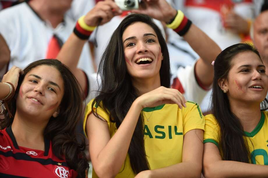 Fans cheer before the Group G football match between Germany and Ghana at the Castelao Stadium in Fortaleza during the 2014 FIFA World Cup on June 21, 2014. AFP PHOTO / PATRIK STOLLARZ        (Photo credit should read PATRIK STOLLARZ/AFP/Getty Images) Photo: AFP/Getty Images