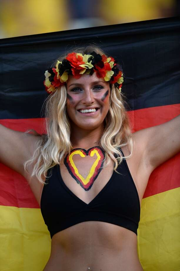 A German supporter cheers prior to a Group G football match between Germany and Ghana at the Castelao Stadium in Fortaleza during the 2014 FIFA World Cup on June 21, 2014.     AFP PHOTO / CARL DE SOUZA        (Photo credit should read CARL DE SOUZA/AFP/Getty Images) Photo: AFP/Getty Images