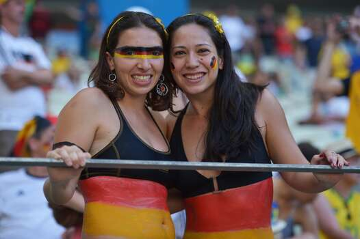 German supporters cheer prior to a Group G football match between Germany and Ghana at the Castelao Stadium in Fortaleza during the 2014 FIFA World Cup on June 21, 2014.     AFP PHOTO / CARL DE SOUZA        (Photo credit should read CARL DE SOUZA/AFP/Getty Images) Photo: AFP/Getty Images